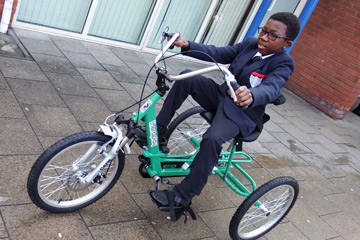Image of Theo on a trike
