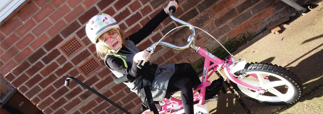 Image of a girl on a trike